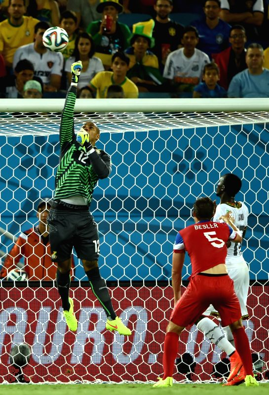 Ghana's goalkeeper Adam Larsen Kwarasey blocks the ball during a Group G match between Ghana and U.S. of 2014 FIFA World Cup at the Estadio das Dunas Stadium in ...