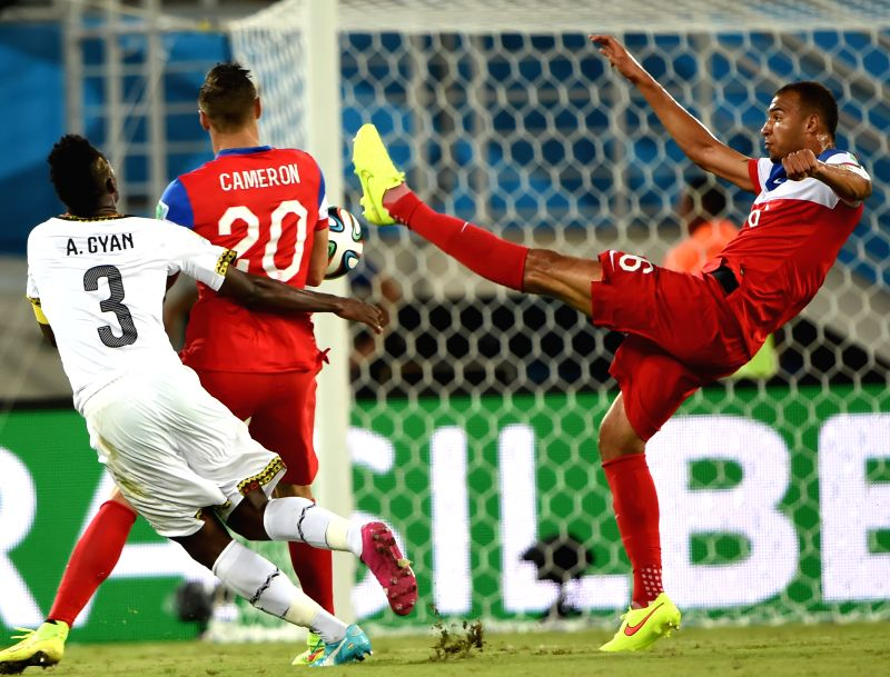 John Brooks (R) of U.S. blocks the shot during a Group G match between Ghana and U.S. of 2014 FIFA World Cup at the Estadio das Dunas Stadium in Natal, Brazil, June ..