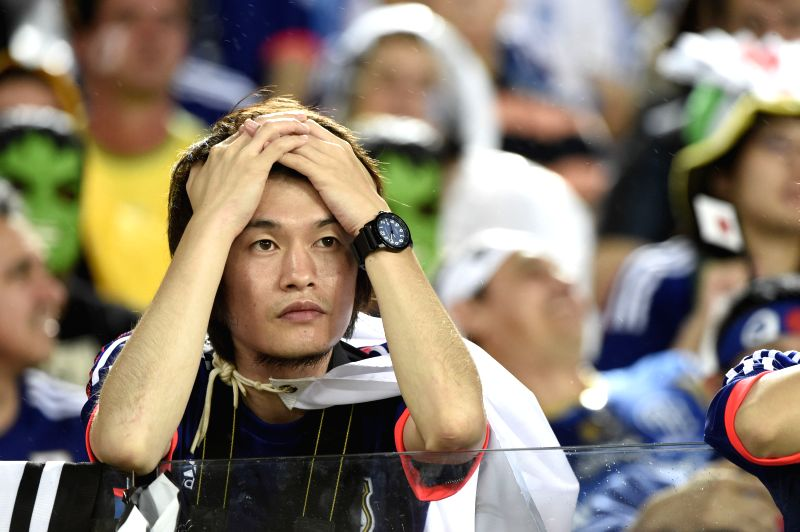 Japan's fan looks on during a Group C match between Japan and Greece of 2014 FIFA World Cup at the Estadio das Dunas Stadium in Natal, Brazil, June 19, 2014. The ...