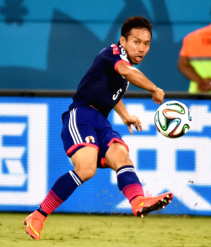 Japan's Yuto Nagatomo passes the ball during a Group C match between Japan and Greece of 2014 FIFA World Cup at the Estadio das Dunas Stadium in Natal, Brazil, June ..