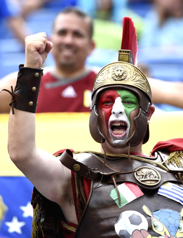 An Italy's fan poses before a Group D match between Italy and Uruguay of 2014 FIFA World Cup at the Estadio das Dunas Stadium in Natal, Brazil, June 24, 2014. ...