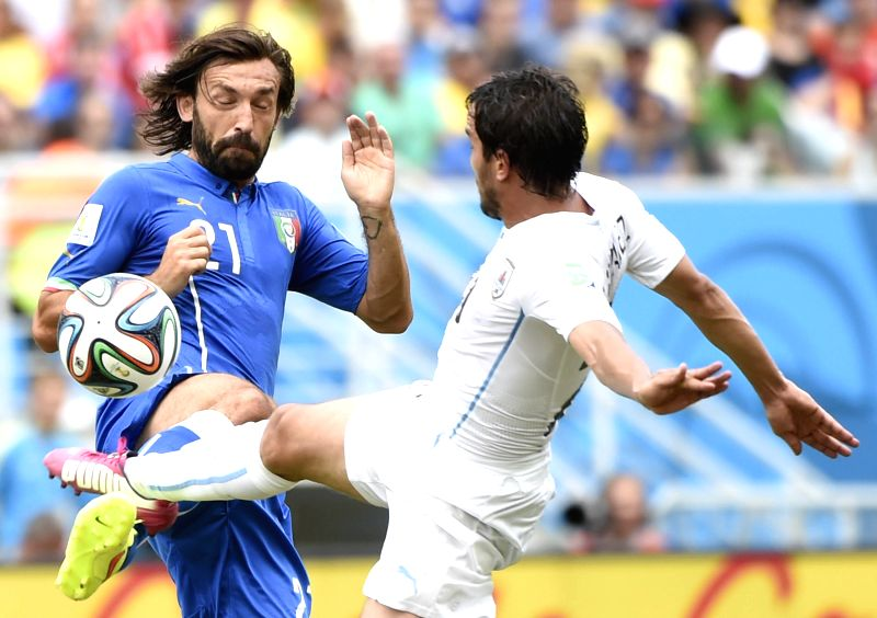 Italy's Andrea Pirlo vies for the ball during a Group D match between Italy and Uruguay of 2014 FIFA World Cup at the Estadio das Dunas Stadium in Natal, Brazil, June