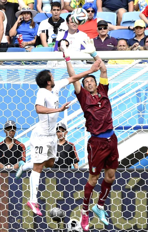 Italy's goalkeeper Gianluigi Buffon vies with Uruguay's Alvaro Gonzalez during a Group D match between Italy and Uruguay of 2014 FIFA World Cup at the Estadio das Dunas .