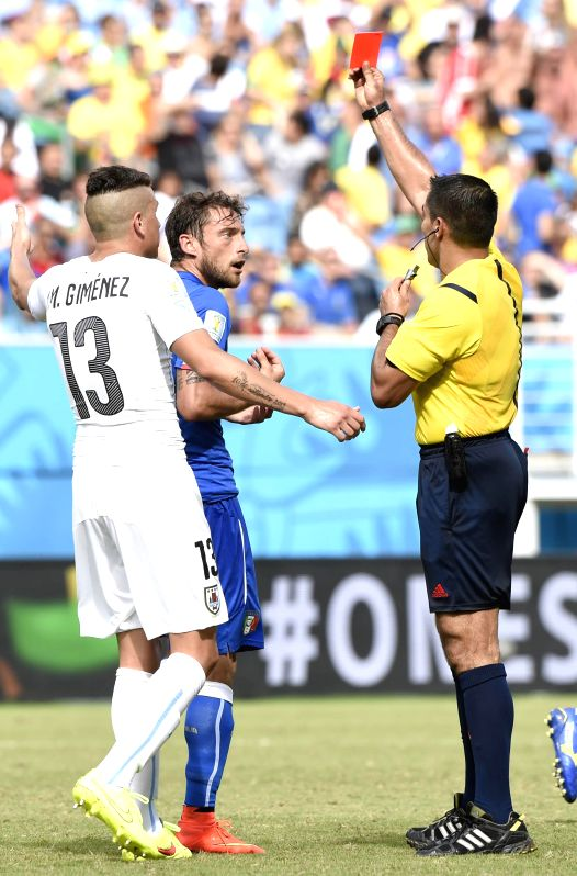 Mexican referee Marco Rodriguez gives a red card to Italy's Claudio Marchisio (C) during a Group D match between Italy and Uruguay of 2014 FIFA World Cup at the Estadio .