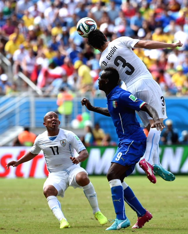 Uruguay's Diego Godin jumps for the ball during a Group D match between Italy and Uruguay of 2014 FIFA World Cup at the Estadio das Dunas Stadium in Natal, Brazil, June .