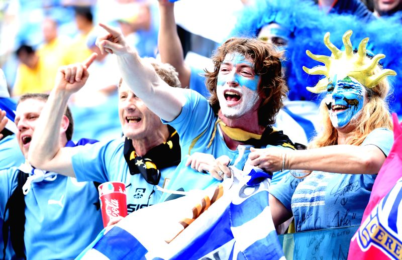 Uruguay's fans pose before a Group D match between Italy and Uruguay of 2014 FIFA World Cup at the Estadio das Dunas Stadium in Natal, Brazil, June 24, 2014. ...