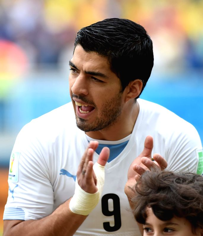 Uruguay's Luis Suarez applauds before a Group D match between Italy and Uruguay of 2014 FIFA World Cup at the Estadio das Dunas Stadium in Natal, Brazil, June 24, ...