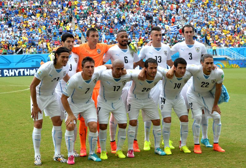 Uruguay's players pose for a group photo during a Group D match between Italy and Uruguay of 2014 FIFA World Cup at the Estadio das Dunas Stadium in Natal, Brazil, ...