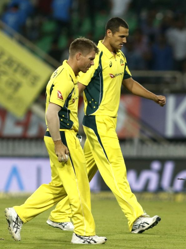 Nathan Coulter-Nile and David Warner during the first T20 match between India and Australia at JSCA International Stadium in Ranchi on Oct 7, 2017.