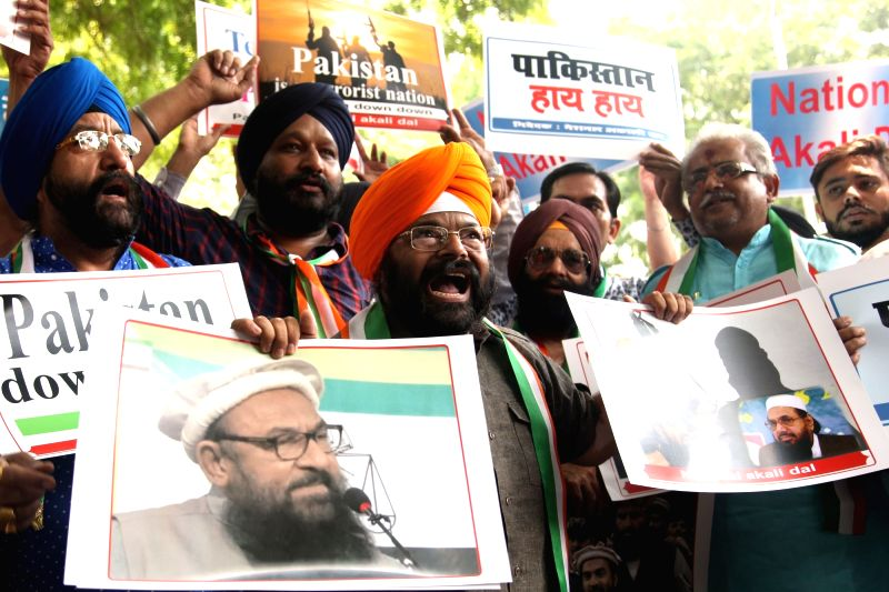 National Akali Dal (NAD) activists stage a demonstration led by party president Paramjeet Singh Pamma against Pakistan in New Delhi on Sept 10, 2017. - Paramjeet Singh Pamma