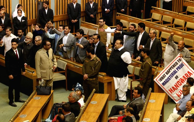 National Conference legislators and Independent Kashmir legislator Er Rashid stage a demonstration regarding Handwara killings during a joint sitting of the Legislature at Sher-i-Kashmir ...