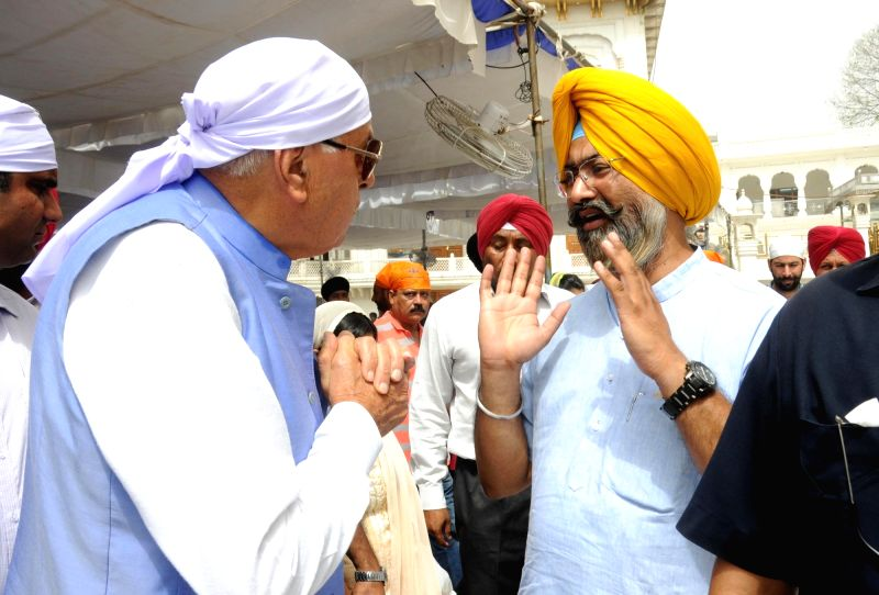 National Conference (NC) president Dr Farooq Abdullah pays obeisance at the Golden Temple in Amritsar, on May 28, 2016.