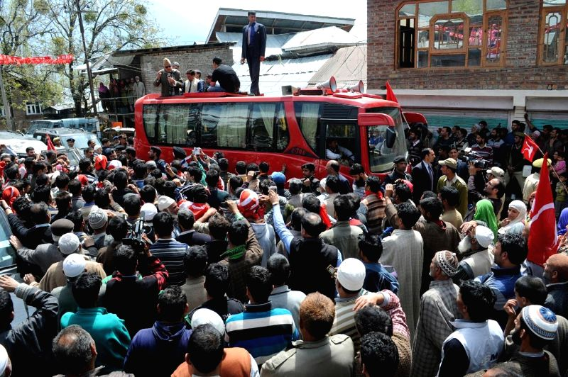 National Conference president and Union minister Farooq Abdullah during a road show in Ganderbal of Jammu and Kashmir April 23, 2014. - Farooq Abdullah