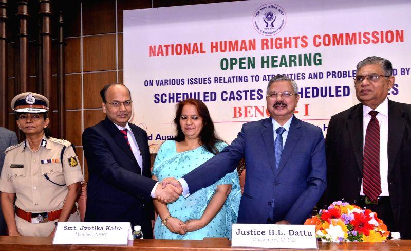 National Human Rights Commission Chairman Justice H L Dattu with the members of the Commission - Vijay Bhaskar, Jyotika Kalra and D. Murugesan and Karnataka DG-IGP Neelamani N. Raju during ...