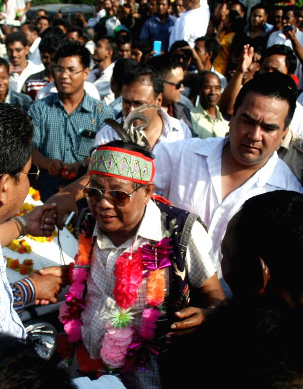 National People's Party chief and former Lok Sabha speaker, Purno Agitok Sangma celebrates after winning Tura Lok Sabha seat for the 10th term in Tura on May 16, 2014.