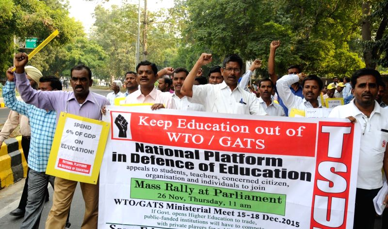 National Platform in defence of Education (NDPE) members stage a demonstration to press for their demand in New Delhi, on Nov 26, 2015.