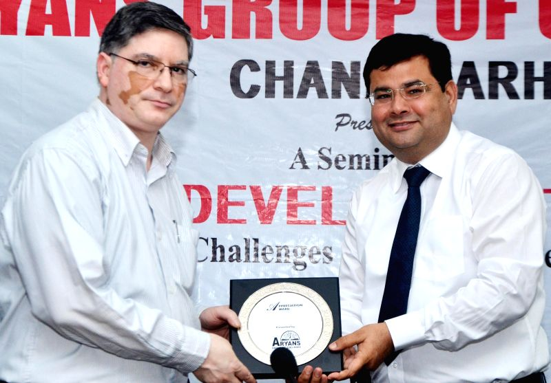"National Skill Development Corporation (NSDC) MD and CEO Dilip Chenoy (L) during  seminar organised on ""Skill Development in India: Challenges and Opportunities"" at PHD Chamber of Commerce ."