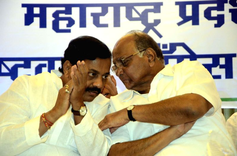 Nationalist Congress Party (NCP) chief Sharad Pawar with newly appointed NCP Maharashtra unit chief Sunil Tatkare during a meeting in Mumbai on June 25, 2014.