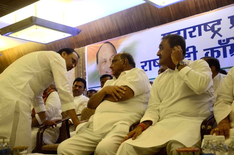 Nationalist Congress Party (NCP) chief Sharad Pawar, party leader Praful Patel, Ajit Pawar and others during a meeting in Mumbai on June 25, 2014. - Praful Patel