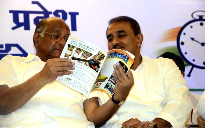 Nationalist Congress Party (NCP) chief Sharad Pawar with party leader Praful Patel during a meeting in Mumbai on June 25, 2014. - Praful Patel