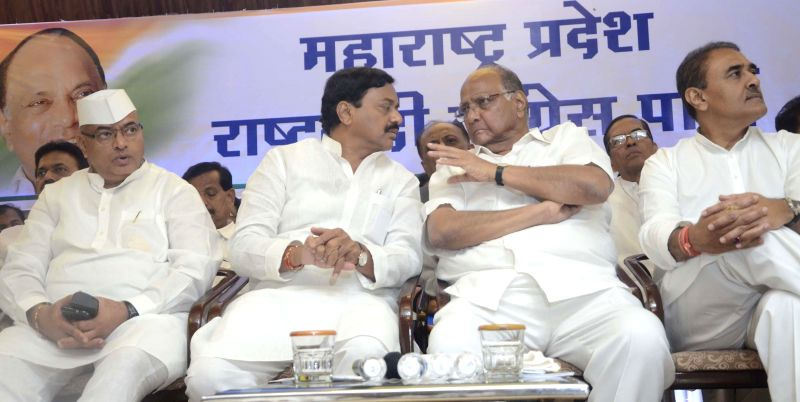 Nationalist Congress Party (NCP) chief Sharad Pawar, party leader Praful Patel, newly appointed NCP Maharashtra unit chief Sunil Tatkare and others during a meeting in Mumbai on June 25, 2014. - Praful Patel