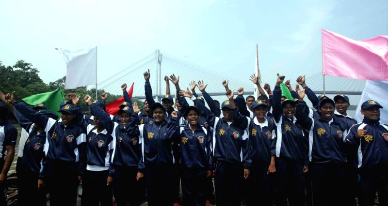 Navy National Cadet Corps (NCC) cadets of West Bengal and Sikkim celebrate after completing their sail from Farakka to Kolkata during the NCC sailing expedition 2018, at Man of War Jetty ...