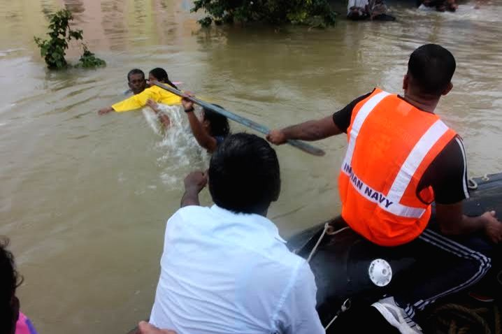 Navy personnel rescue people from submerged houses in Chennai on Dec.3,  2015.