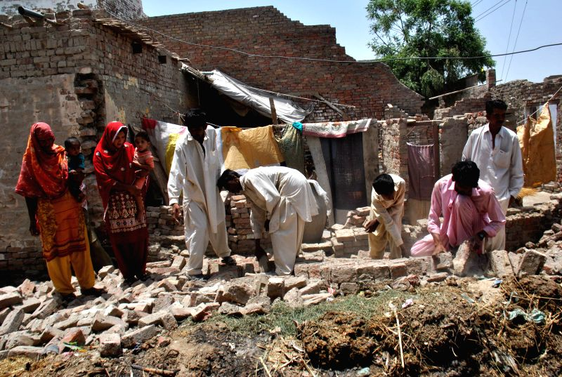 People check in earthquake hit area of southern Pakistan's Nawabshah, May 9, 2014. At least two people were killed and 40 others injured when a 5.0-magnitude ...