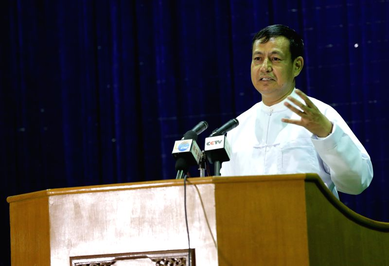 Myanmar presidential spokesman and Information Minister U Ye Htut speaks during a press conference after a high-level six-party talks in Nay Pyi Taw, Myanmar, ... - U Y