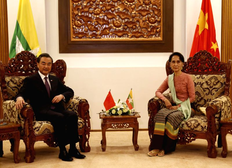 NAY PYI TAW, April 5, 2016 - Myanmar's Foreign Minister Aung San Suu Kyi (R) meets with her Chinese counterpart Wang Yi in Nay Pyi Taw, Myanmar, April 5, 2016. Chinese Foreign Minister Wang Yi ... - Aung San Suu Kyi