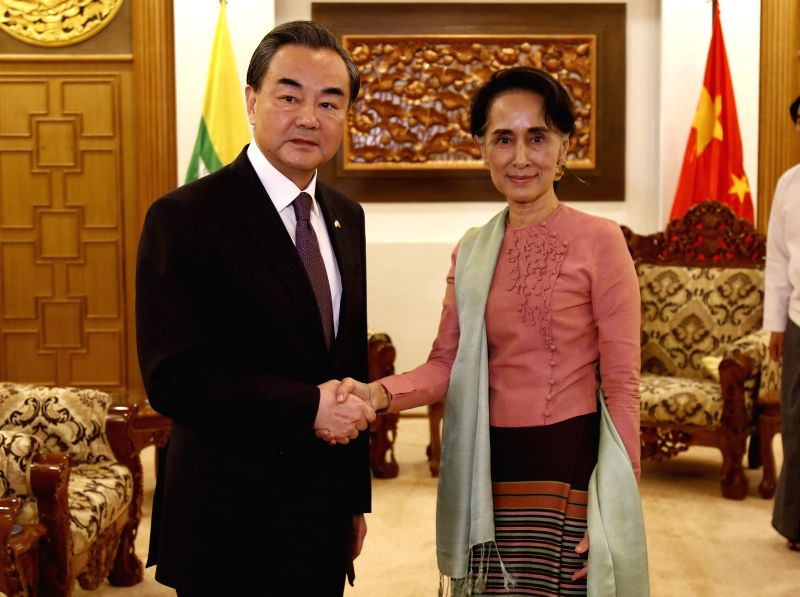 NAY PYI TAW, April 5, 2016 - Myanmar's Foreign Minister Aung San Suu Kyi (R) shakes hands with her Chinese counterpart Wang Yi in Nay Pyi Taw, Myanmar, April 5, 2016. Chinese Foreign Minister Wang Yi ... - Aung San Suu Kyi