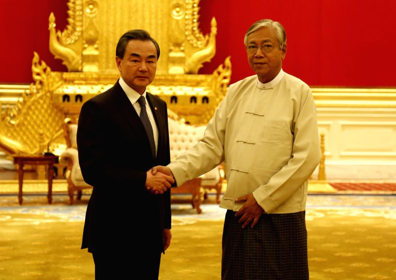 NAY PYI TAW, April 6, 2016 - Chinese Foreign Minister Wang Yi (L) shakes hands with Myanmar President U Htin Kyaw during their meeting in Nay Pyi Taw, Myanmar, on April 6, 2016. - Wang Y