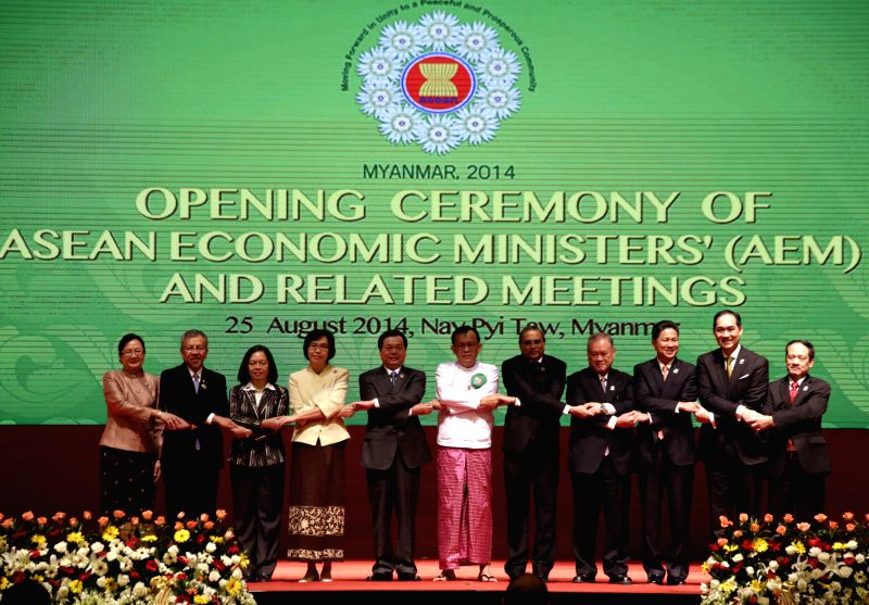 ASEAN Secretary-General Le Luong Minh (1st R) and ASEAN economic ministers' pose for a group photo during the opening ceremony of the 46th ASEAN Economic ...