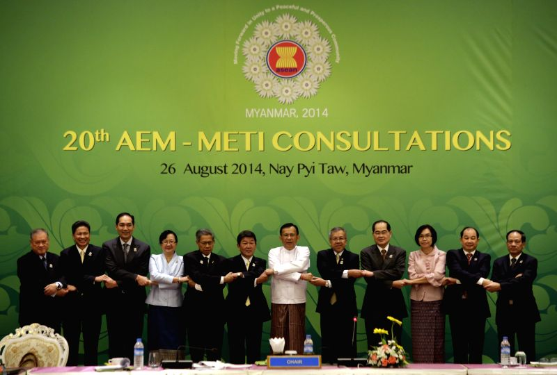 NAY PYI TAW, Aug. 26 2014 Toshimitsu Motegi (left, 6th), Japan's minister of economy, trade and industry and ASEAN Economic Ministers pose for a photo and during the Consultations between