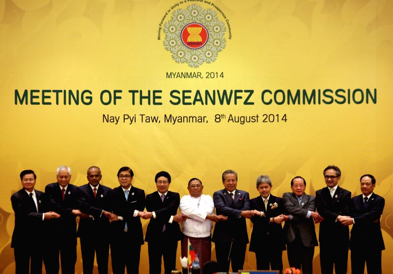 ASEAN foreign ministers pose for a group photo during the meeting of the Southeast Asia Nuclear-Weapon-Free-Zone (SEANWFZ) Commission at Myanmar International ...