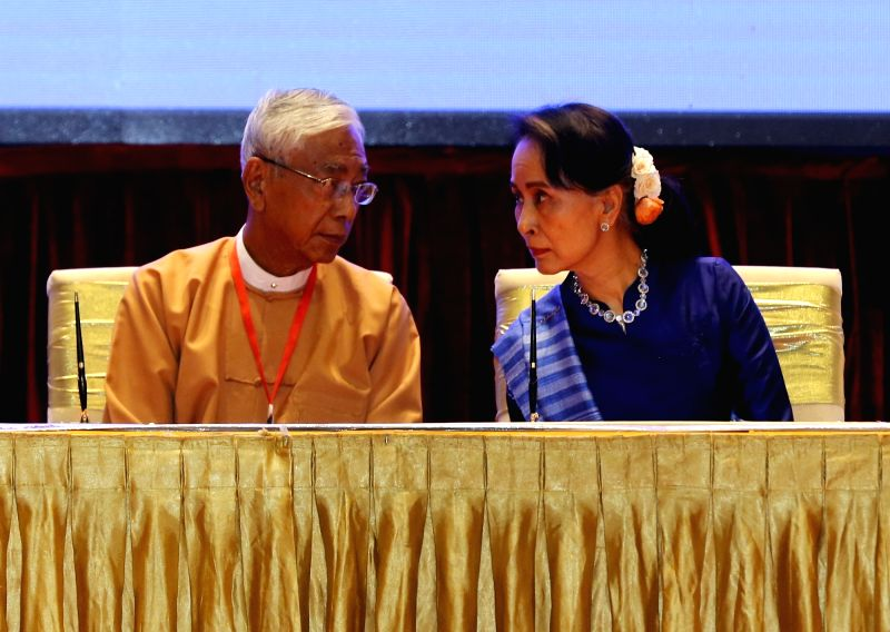 NAY PYI TAW, Feb. 13, 2018 - Myanmar's President U Htin Kyaw (L) talks with Myanmar's State Counselor Aung San Suu Kyi during the signing ceremony of Nationwide Ceasefire Accord at the Myanmar ...