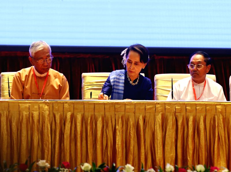 NAY PYI TAW, Feb. 13, 2018 - Myanmar's State Counselor Aung San Suu Kyi (C), signs on documents during the signing ceremony of Nationwide Ceasefire Accord at the Myanmar International Convention ...