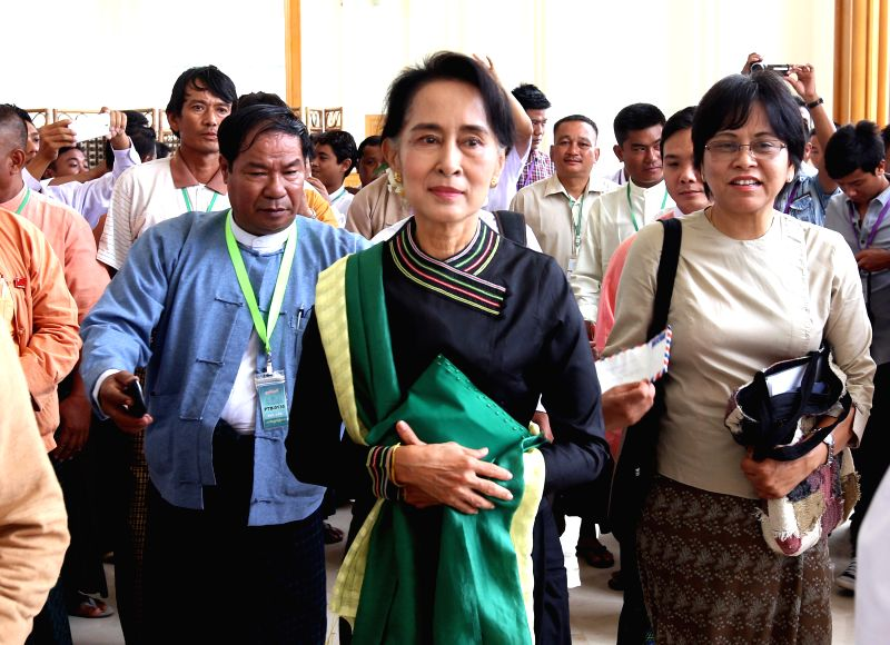 Aung San Suu Kyi (C), leader of Myanmar's National League for Democracy (NLD), walks to attend the 10th regular session of the Union Parliament in Nay Pyi Taw, .