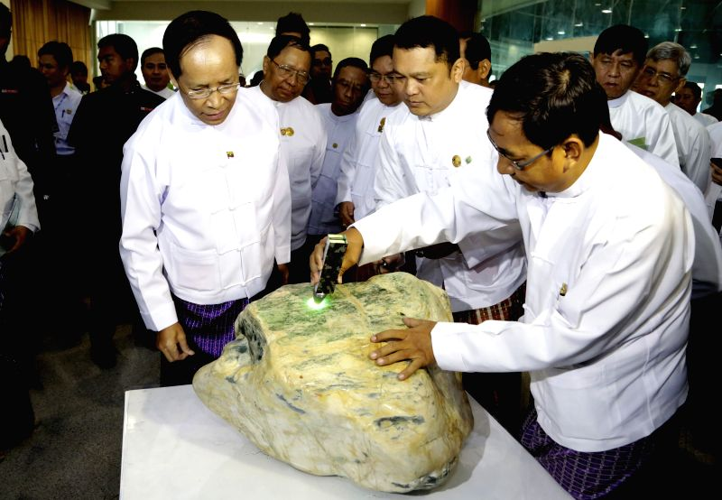 Myanmar Vice President Dr. Sai Mauk Kham (L, front) views the most expensive jade displayed during the 51st annual Myanmar Gems Emporium at Maniyadana Emporium .