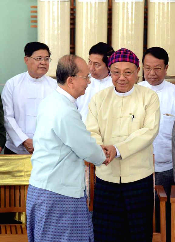 Myanmar President U Thein Sein (L, front) shakes hands with General Secretary of the Kachin Independence Organization (KIO) Dr. La Ja (R, front) during their ...