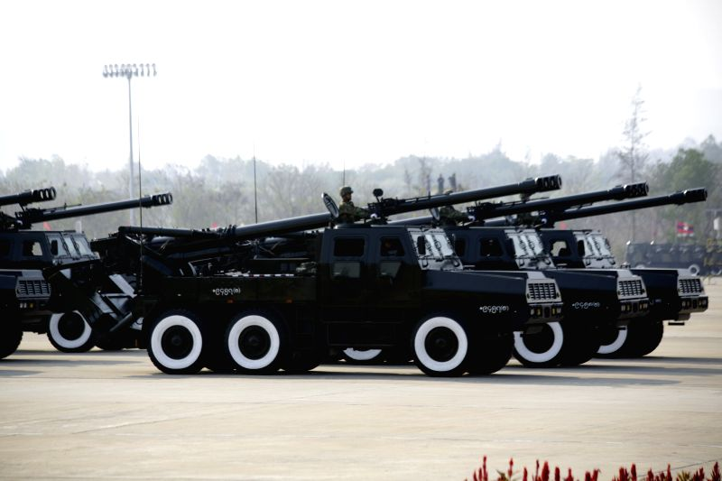 Armoured vehicles take part in a military parade to mark the 70th anniversary of the Armed Forces Day in Nay Pyi Taw, Myanmar, March 27, 2015. (Xinhua/U ...