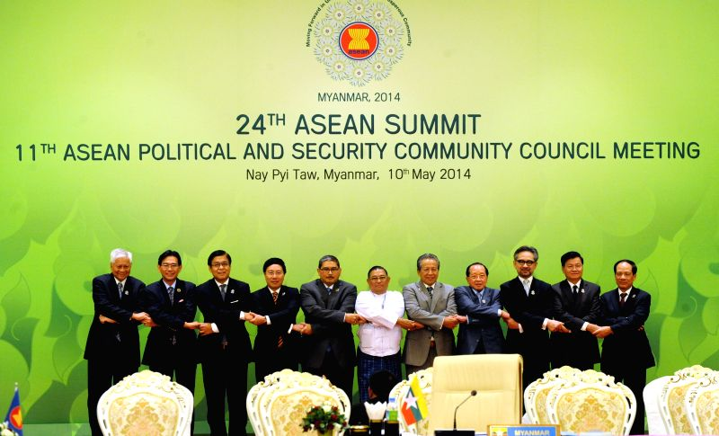 ASEAN Secretary-General Le Luong Minh (1st R) and attendees pose for photos prior to the 11th ASEAN Political and Security Community Council Meeting during the ..