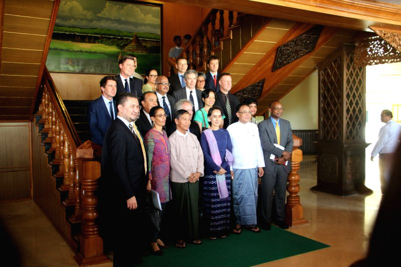 NAY PYI TAW, May 11, 2016 - Myanmar's State Counselor and Foreign Minister Aung San Suu Kyi (3rd R, 1st row) poses for a photo with representatives of UN in Nay Pyi Taw, capital of Myanmar, on May ... - Aung San Suu Kyi
