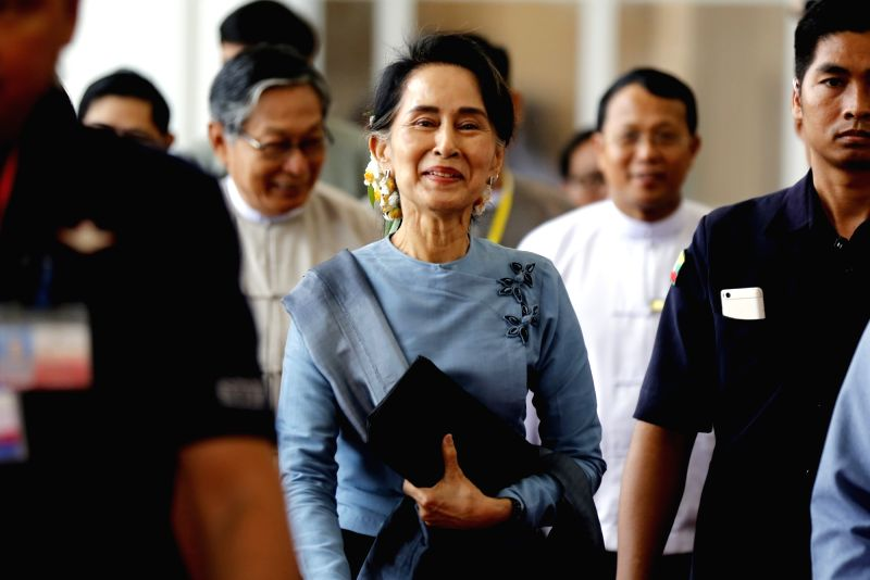 NAY PYI TAW, May 28, 2017 - Myanmar's State Counselor Aung San Suu Kyi (C) leaves after attending the meeting of the Union Peace Dialogue Joint Committee (UPDJC) during the Second Meeting of ...
