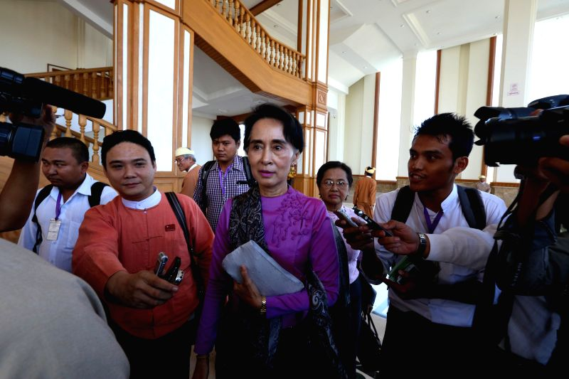 Nay Pyi Taw (Myanmar): Aung San Suu Kyi (C), leader of Myanmar's National League for Democracy (NLD), speaks to media after attending the 11th regular session of the Union Parliament in Nay Pyi Taw, .