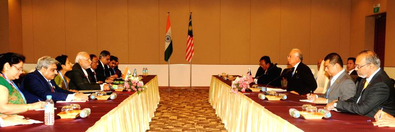 Nay Pyi Taw: Prime Minister Narendra Modi during a meeting with the Prime Minister of Malaysia, Najib Razak, at Nay Pyi Taw, Myanmar on Nov 12, 2014. - Narendra Modi