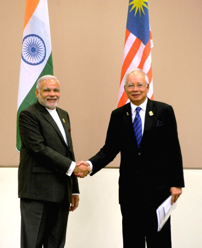 Nay Pyi Taw: Prime Minister Narendra Modi meets the Prime Minister of Malaysia, Najib Razak, at Nay Pyi Taw, Myanmar on Nov 12, 2014. - Narendra Modi