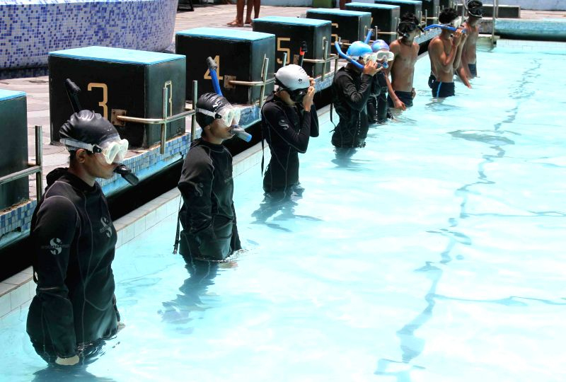 NCC cadets during Scuba Diving camp organised by 1 Maharashtra Naval Unit NCC at the Western Naval Command Swimming Pool in Colaba, Mumbai on July 25, 2014.