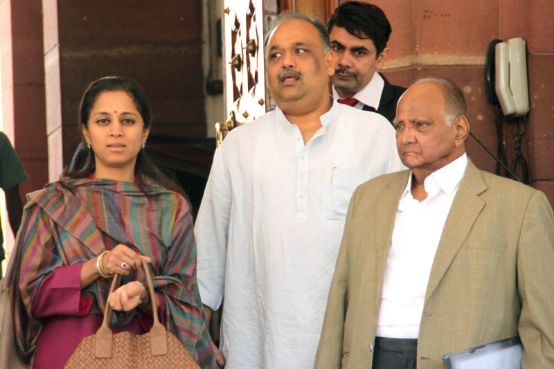 NCP chief Sharad Pawar and party MP Supriya Sule at the Parliament premises in New Delhi, on Dec 1, 2014.