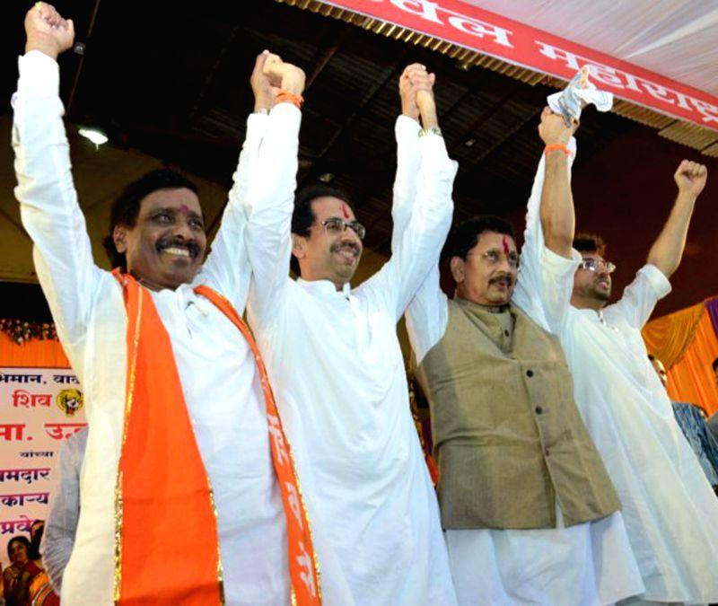 NCP leader Deepak Kesarkar joins Shiv Sena in presence of Shiv Sena chief Uddhav Thackeray in Konkan on Aug 5, 2014.